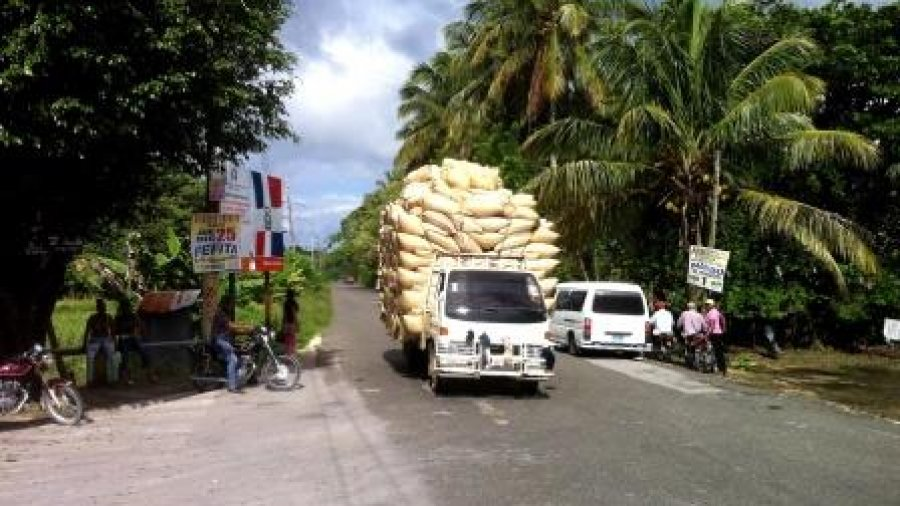 Overloaded rice truck from front